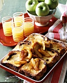 Bread & butter pudding with caramelised apples, orange juice