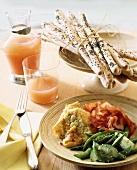 Brunch: corn soufflé, vegetables, ham, grissini and juice