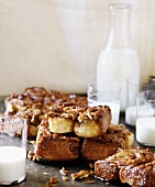 Sweet pecan cakes, glasses of milk and bottle of milk