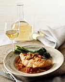 Salmon with tomato and olive sauce, white wine