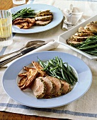Pork fillet with caraway crust, green beans, sweet potatoes
