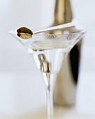 Martini with stuffed olive