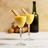 Zabaione with sponge fingers in stemmed glasses