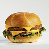 Double Cheeseburger with Lettuce on a White Background