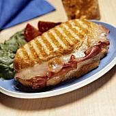 Toasted mozzarella and prosciutto sandwich