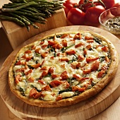 Asparagus, Tomato and Pesto Pizza on Wooden Cutting Board