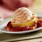 A slice of sponge cake with strawberry ice cream & fresh strawberries