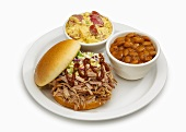 Pork sandwich with baked beans and potato salad