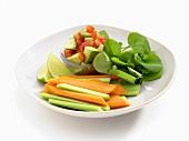 Avocado and tomato salad, carrot and celery sticks