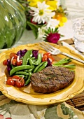 Grilled steak with sugar snap peas and tomatoes