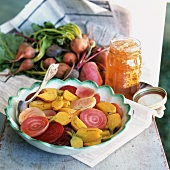 Yellow and red beetroot with honey