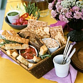Focaccia with tomato dip and crackers with seafood dip