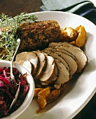 Sliced pork fillet with apples, red cabbage and rosemary