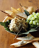 Cheese ball with nuts, Melba toast, grapes, pear