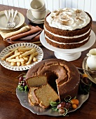 A Dessert Buffet with Bundt Cake, Layered Carrot Cake with Frosting and Finger Cookies