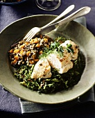 Chicken breast on leafy vegetables and wild rice