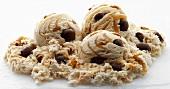 Three Scoops of Turtle Pecan Ice Cream on White Background