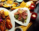 Assorted Seafood Dishes, Sliced Tuna on Bed of Greens, Platter of Lobster