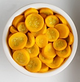 Overhead of a Bowl of Sliced Crookneck Squash