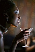 Profile of Woman in Nightclub Holding Martini