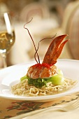 Elegant Lobster Entree with Roe and Baby Bok Choy on Bed of Pasta