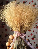 A bouquet of wheat ears and fresh eggs