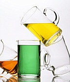 Glass jugs with various different coloured drinks