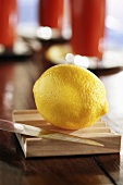 Whole lemon with knife