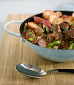 Beef with vegetables, tomato sauce and red potatoes