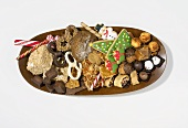 Christmas biscuits and sweets on oval plate