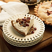Piece of ice cream cake with cranberries, pecans & caramel