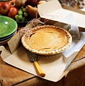 Whole pumpkin pie in a cardboard box (USA)