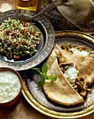 Middle Eastern Dishes; Beef Stuffed Pita Pockets with Yogurt Sauce and a Bowl of Tabouleh