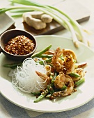 Shrimp with Green Beans and Rice Noodles; Bowl of Chili Flakes