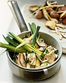 Soup Ingredients in a Pot; Leeks, Mushrooms and Sliced Potatoes