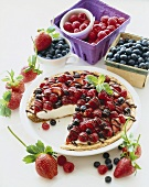 Cheesecake Topped with Fresh Berries and Chocolate Sauce, Slice Removed, Fresh Berries