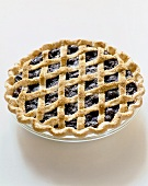 Blueberry Pie with Lattice Crust on a White Background