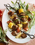 Beef and Vegetable Kabobs on a White Platter, Fresh Herbs