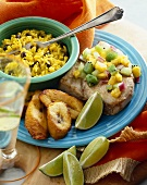 Tuna Topped with Mango Kiwi Salsa with Fried Plantains and a Bowl of Rice and Beans; Lime Wedges