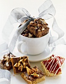 Assorted Dessert Squares In and Beside a Mug Wrapped in Ribbon