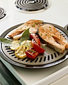 Salmon Steaks and Vegetables on a Stove Top Grill
