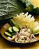 Calamari Salad with Cucumber Slices and Cabbage