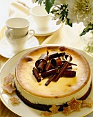 Cheesecake with Chocolate Crust Topped with Chocolate Curls; Tea Cups