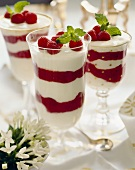 Layered Raspberry Parfaits Topped with Fresh Raspberries