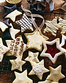 Various sized shortbread stars on a wire rack