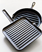 Two Non-stick Grill Pans; One Square and One Round; White Background