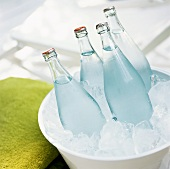 Four bottles of water in an ice bucket