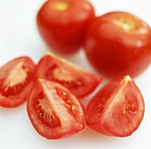 Tomato wedges and two whole tomatoes