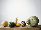 Assorted squashes on wooden table