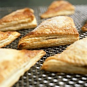 Freshly baked turnovers on cake rack